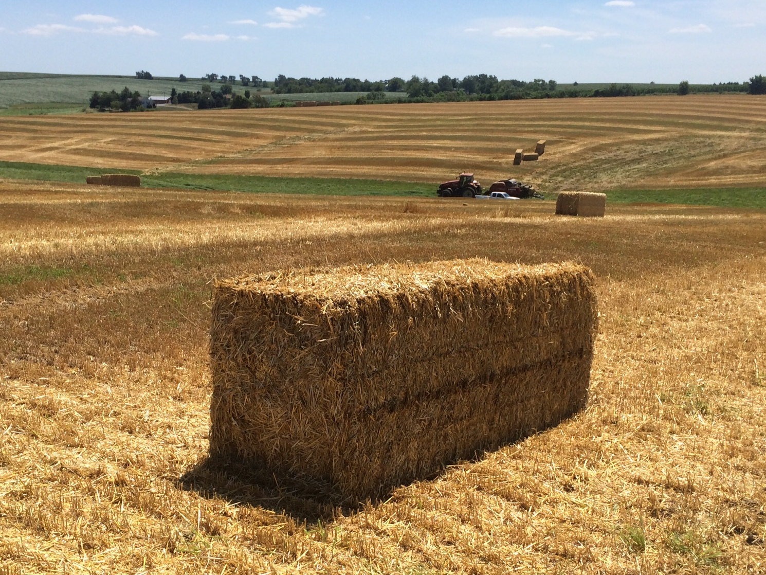 What are some benefits of a square hay baler?